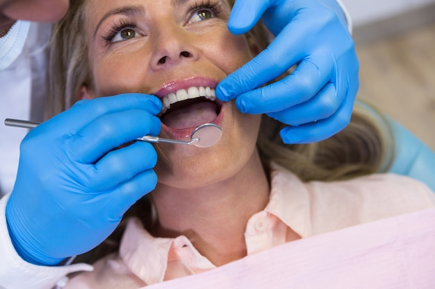 Dentist treating patient at medical clinic