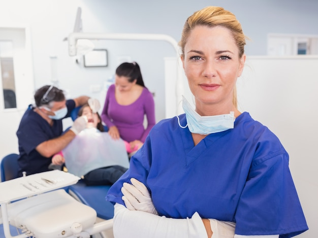 Dentist with folded arms