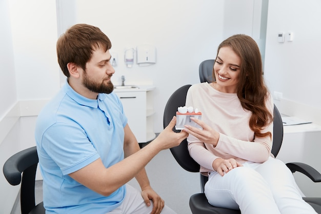 Dentist with satisfied patient