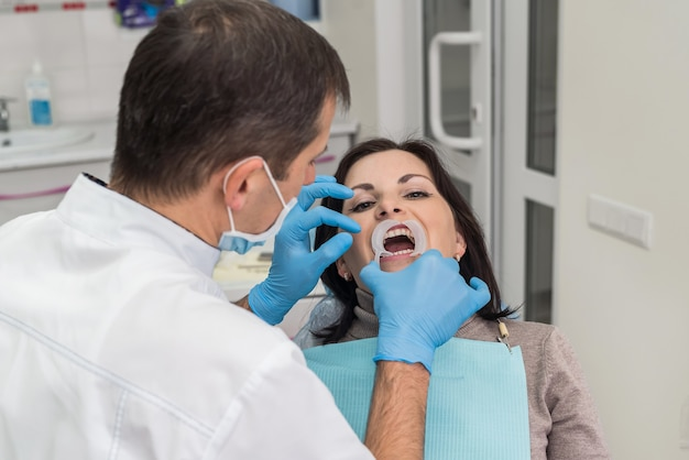 Dentist working with patient in dentist office