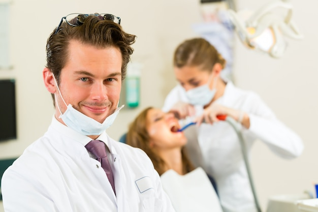 Dentists in his surgery