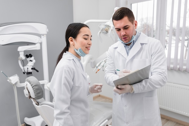 Dentists looking at clipboard