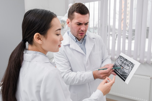 Dentists looking at scan