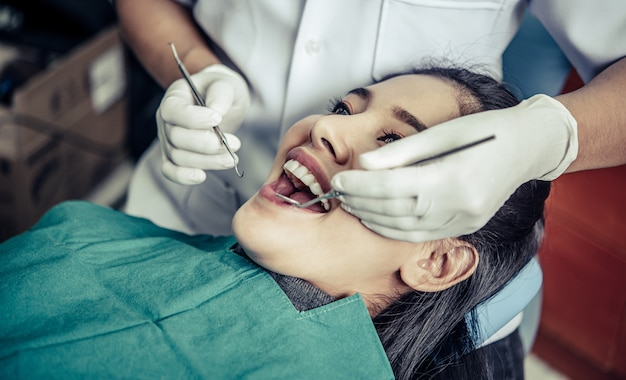 Dentists treat patients' teeth.