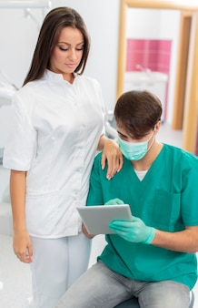 Dentists with tablet