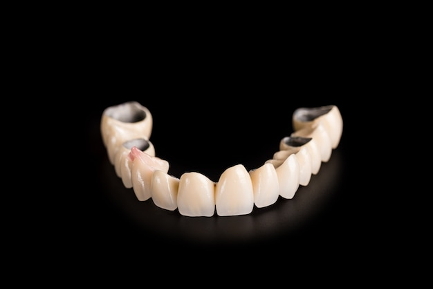 Denture on black background