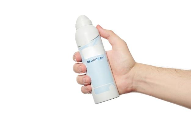 Дезодорант в ручном узоре. бутылка с распылителем антиперспиранта на белом изолированном фоне.