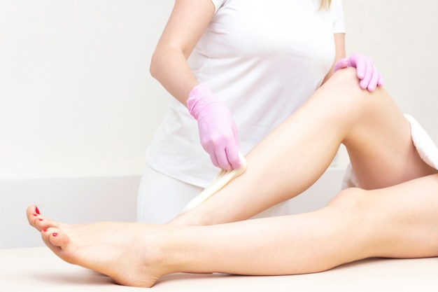 Depilation and massage. beautiful female legs with smooth skin.
