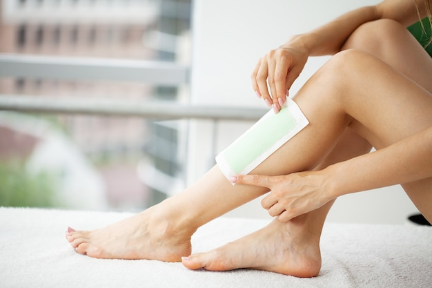 Depilation procedure with wax on the legs