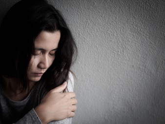 Depressed broken hearted woman sitting alone in dark room at home. Lonely , Sad, LOVE