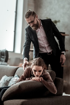 Depressed daughter. businessman coming home and seeing his daughter feeling depressed and lonely