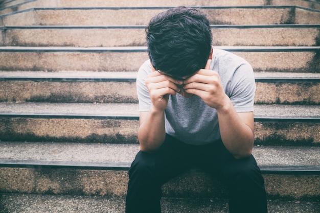 Depressed man. man suffering from headache