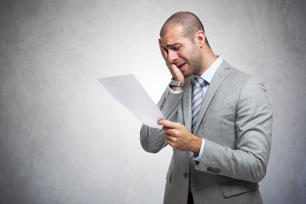 Depressed man reading a document