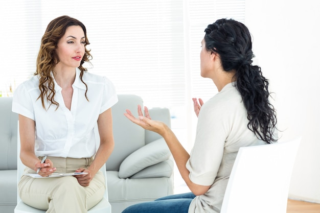 Depressed woman talking to her therapist