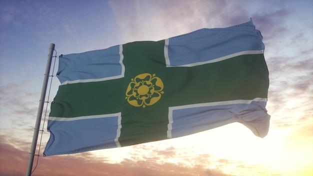 ダービーシャーの旗、イギリス、風、空、太陽の背景に手を振っています。 3dレンダリング。