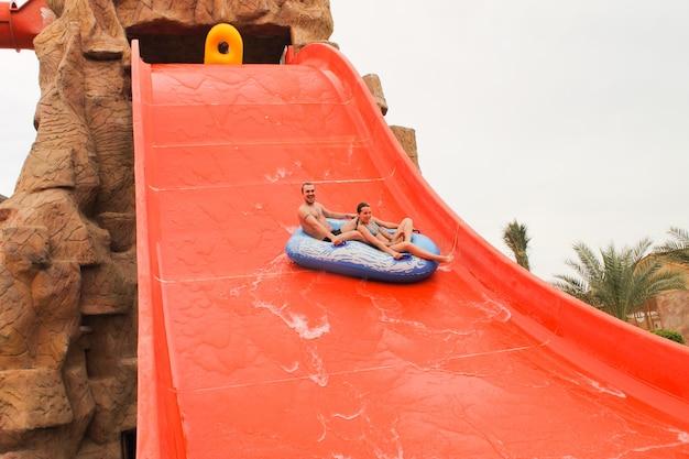 Descent on the water slide in aqua park.