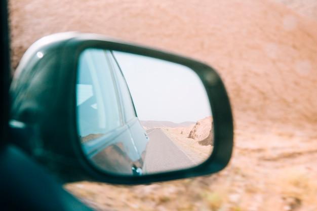 Desert landscape in car mirror