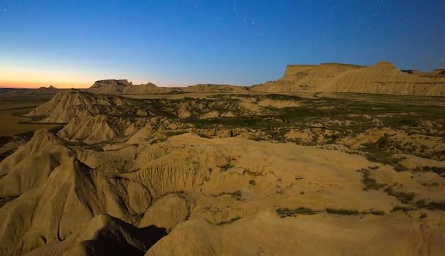 Desert landscape of navarra in   moonlit night