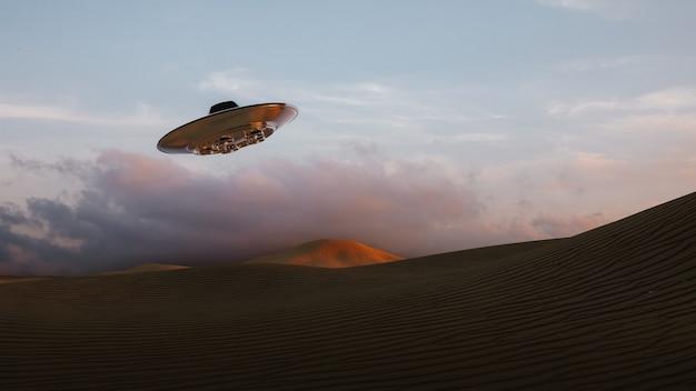 日没時に砂丘の上を飛んでいるエイリアンの空飛ぶ円盤と砂漠の風景