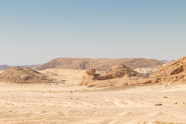 Desert, red mountains, rocks and blue sky. egypt, the sinai peninsula.