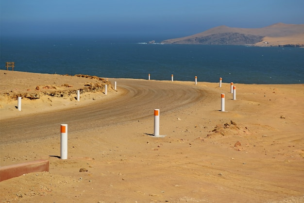 The desert road along the ocean, paracas national reserve in ica region of peru