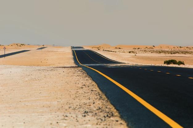 Desert road asphalt with markings