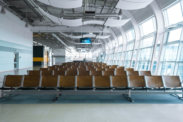 Deserted airport terminal. rows of empty seats in the waiting room