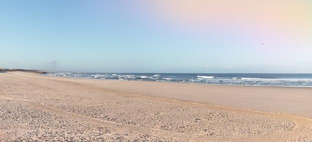Deserted beach on the atlantic sea in portugal