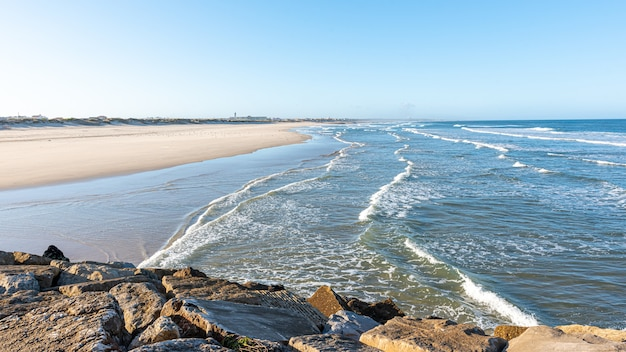 The deserted beach sky sea and sand