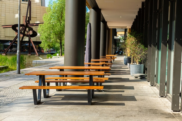Deserted benches on the summer terrace of the restaurant