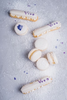 Desiccated coconut over the baked macaroons and eclairs
