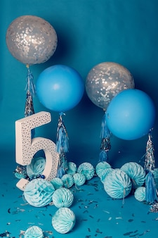 Design for birthday of five years in the blue style