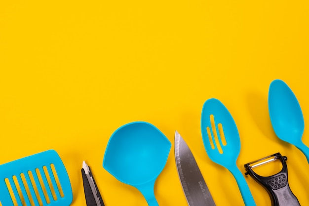 Design concept of kitchen utensils on yellow background