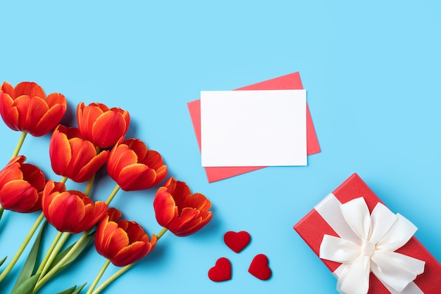 Design concept of mothers day greeting gift with red tulip bouquet
