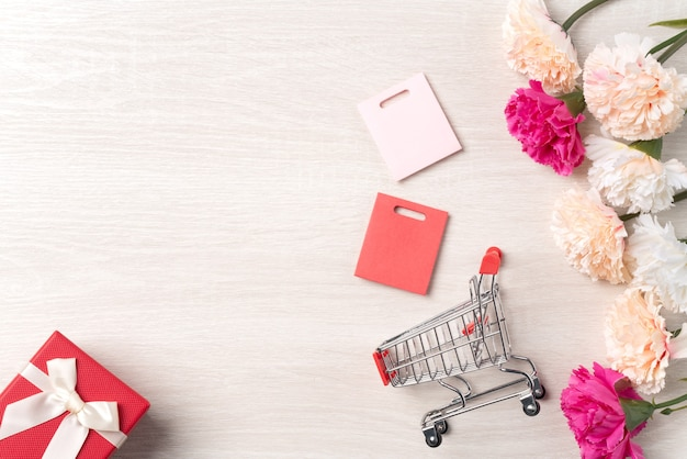 Design concept of mothers day shopping with carnation flower,