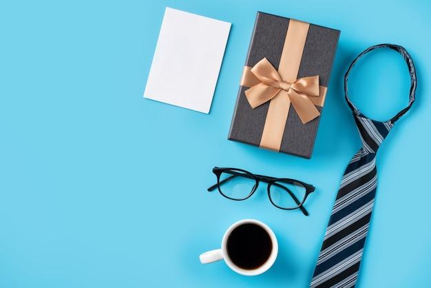 파란색 테이블 배경에 흰색 빈 이랑 인사와 함께 아버지의 날 선물 아이디어의 디자인 개념 평면도.
