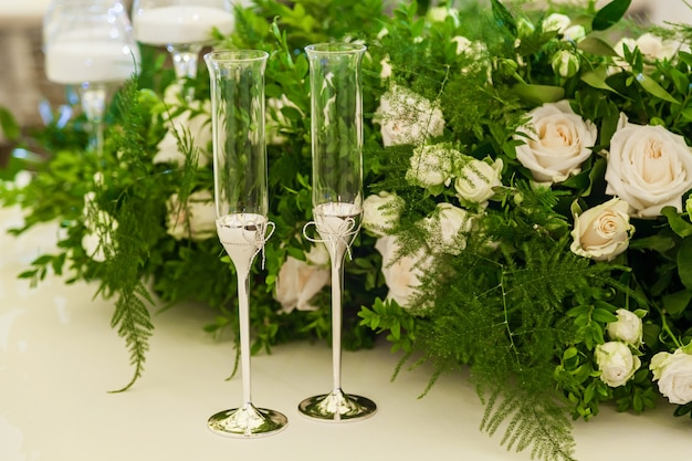 Design and decor decoration of the wedding celebration with white roses green leaves