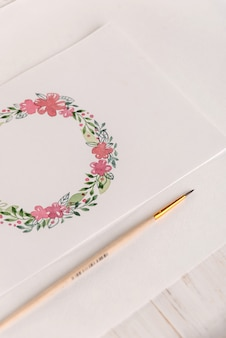Design of flowers frame painted with watercolors on paper