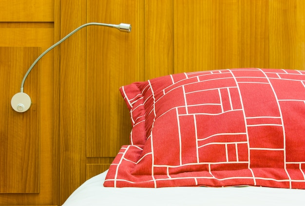 A design red pillow in a modern style bedroom