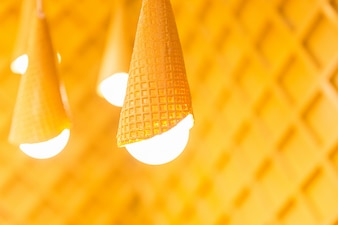 Designed yellow lamps on wooden background. White lights in the room