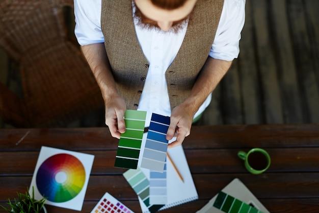 Designer choosing color palette for project