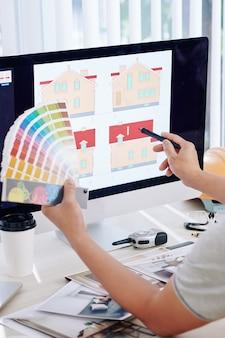 Designer choosing new house color scheme