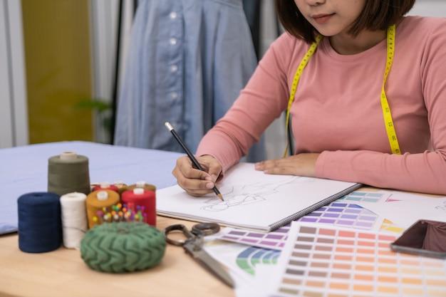 Designer concept. the dressmaker is designing an evening dress in the room