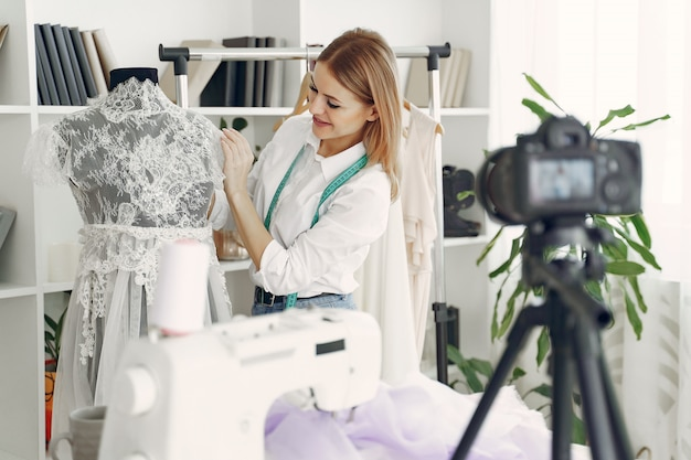 Designer creates clothes and shoots in on camera