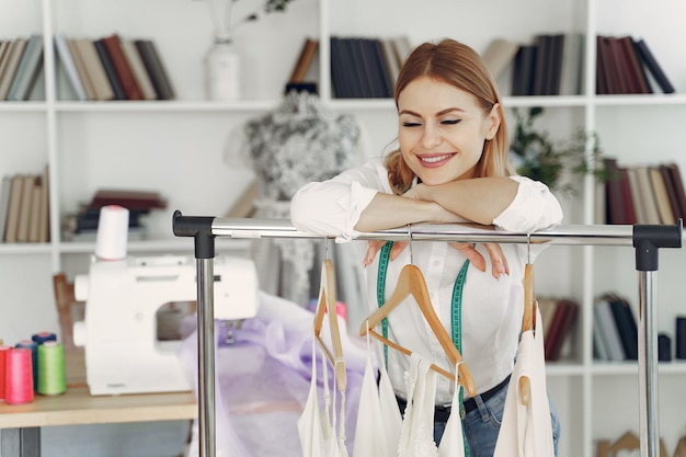 Designer creates clothes in studio
