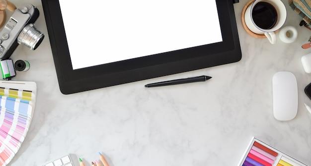 Designer creative studio with blank screen tablet
