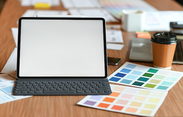 Designer desk space for designers. color charts, model phones and tablet.