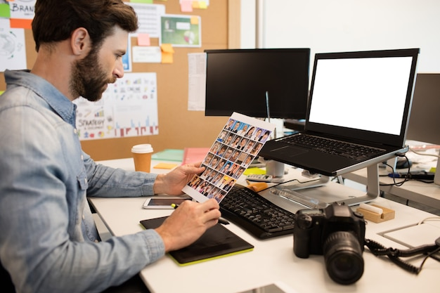 Designer drawing photos with digitizer and laptop