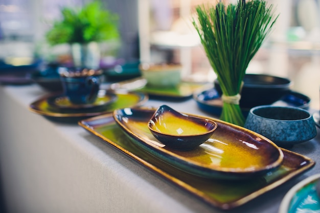 Designer handmade dishes, plates and cups in a stylish boutique.