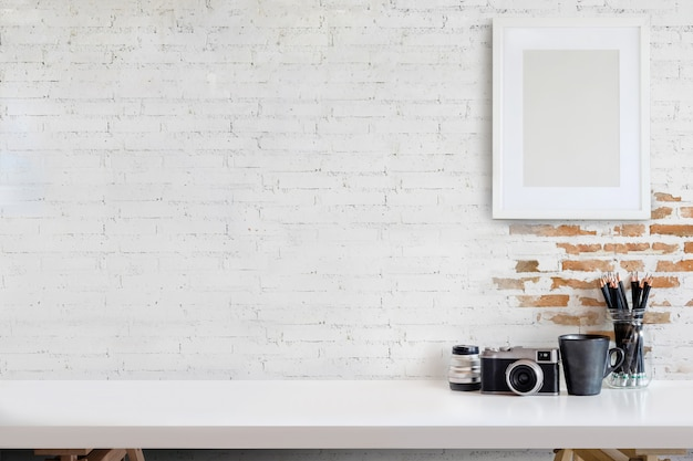 Designer or photographer workspace with computer on home studio.